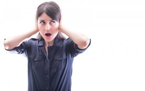 woman-covering-ears-due-to-loud-ac-noises